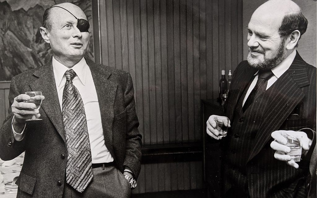 Geoffrey Paul (right) with Moshe Dayan at the JC offices in 1977 (Credit: The Jewish Chronicle)