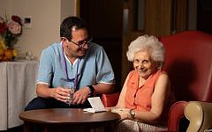 Daniel Carmel-Brown at Jewish Care's Otto Schiff home in Golders Green, with resident Rita Tack (left) (Blake Ezra Photography)
