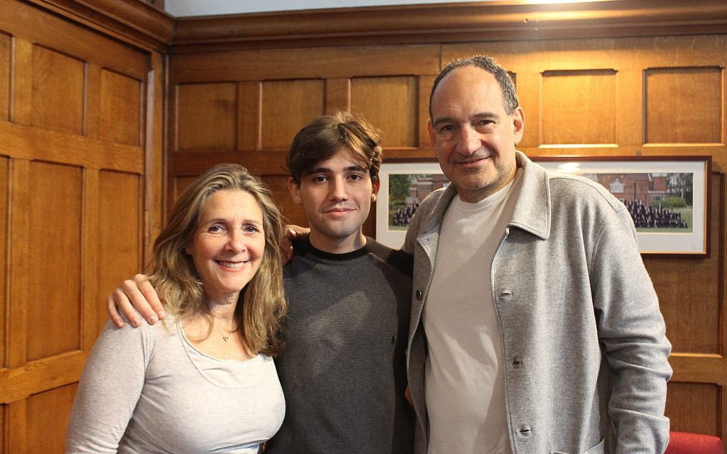 Oliver Russell with his proud parents
