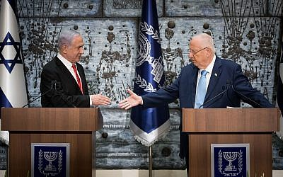 Israeli President Reuven Rivlin (R) hands a letter of appointment for entrusted with forming the next government to Israeli Prime Minister and Chairman of the Likud Party Benjamin Netanyahu (L). Photo by: JINIPIX