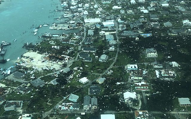 This aerial photo provided by Medic Corps, shows the destruction brought by Hurricane Dorian on Man-o-War cay, Bahamas, Tuesday, Sept.3, 2019 (Medic Corps via AP)