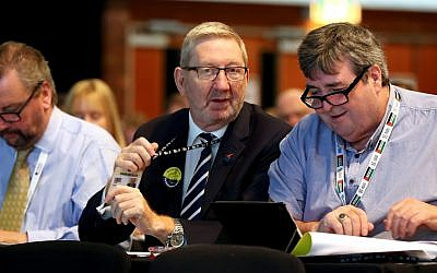 Len McCluskey, General Secretary of Unite the union (left), during the TUC Congress in Brighton. On the left, an attendant wears a pro-Palestine landyard. (PA Photo.(Photo credit: Gareth Fuller/PA Wire)