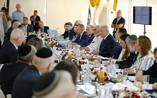 Israeli Prime Minister Benjamin Netanyahu chairs the weekly cabinet meeting being held in a makeshift tent in the Jordan Valley, in the West Bank. (Amir Cohen/Pool via AP)