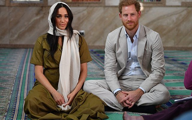 The Duke and Duchess of Sussex during a visit to Auwal Mosque, the oldest mosque in South Africa, on day two of their tour of Africa.   Photo credit: Tim Rooke/PA Wire