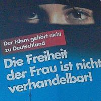 "Election poster of the 'Alternative for Germany' party in local elections at Schleswig-Holstein, 2018. The text says: ""Islam doesn't belong to Germany"", ""Freedom of the woman ist not negotiable!"" (Wikipedia/Author: Rosenkohl)"