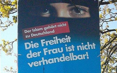 """Election poster of the 'Alternative for Germany' party in local elections at Schleswig-Holstein, 2018. The text says: """"Islam doesn't belong to Germany"""", """"Freedom of the woman ist not negotiable!"""" (Wikipedia/Author: Rosenkohl)"""