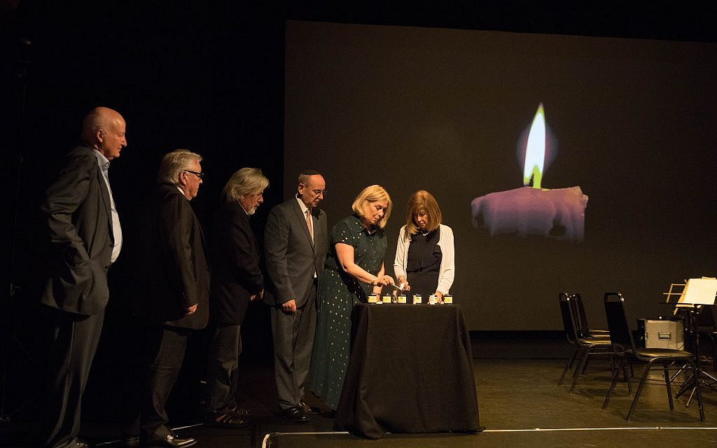 Gena Turgel's family lighting six candles to remember those who perished in the Shoah (Credit: Daniel Morris)