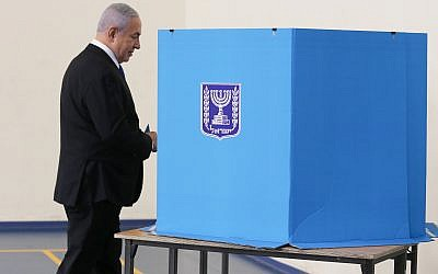 Israeli Prime Minister Benjamin Netanyahu prepares to cast his ballot during the Israeli elections, at a polling station in Jerusalem. (Photo by: Alex kolomoisky-JINIPIX)