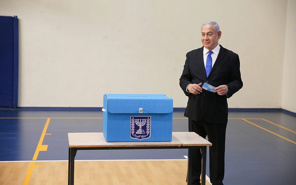 Israeli Prime Minister Benjamin Netanyahu prepares to cast his ballot during the Israeli legislative elections, at a polling station in Jerusalem, 17 September 2019. Israelis are heading to the polls for a second general election, following the prior elections in April 2019, to elect the 120 members of the 22nd Knesset, or parliament. According to the Israel Central Bureau of Statistics, about six million people are eligible to vote. Photo by: Alex kolomoisky-JINIPIX