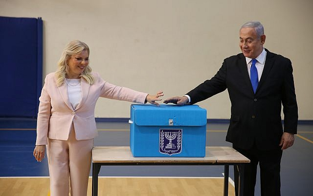 Israeli Prime Minister Benjamin Netanyahu (R) and his wife Sara Netanyahu (L) cast their ballots during the Israeli legislative elections, at a polling station in Jerusalem, 17 September 2019. . Photo by: Alex kolomoisky-JINIPIX