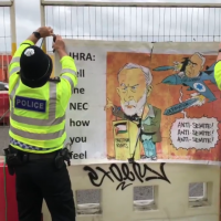Police take down controversial poster depicting Bibi Netanyahu targeting Jeremy Corbyn, as seen at Labour conference (Theo Usherwood on Twitter)