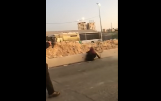 Screenshot from video showing a Palestinian woman wielding a knife and being shot dead