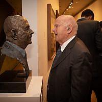 Sir Ben Helfgott with the sculpture of him