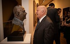 Sir Ben Helfgott with the sculpture of him