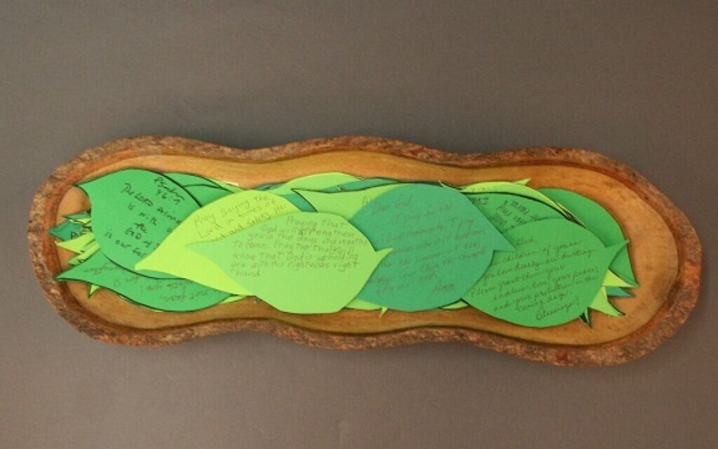 A wooden bowl holding notes of condolence shaped like leaves, sent by a church in Pittsburgh following the synagogue shooting. (Courtesy of the Tree of Life Congregation and Rauh Jewish History Program & Archives)