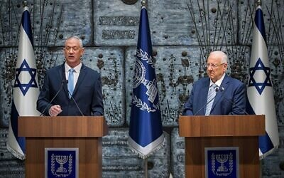 Israeli President Reuven Rivlin (R) hands a letter of appointment for entrusted with forming the next government to leader of the Blue and White political party Benny Gantz (L) at the President's residence in Jerusalem, Israel, 23 October 2019.  Photo by: JINIPIX