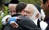 Rabbi Yisroel hugs a member of the congregation of Chabad of Poway the day after a deadly shooting took place there, on Sunday, April 28, 2019 in Poway, Calif. (Credit Image: © TNS via ZUMA Wire)