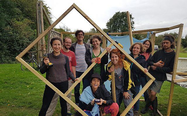 Extinction Rebellion Jews at Sadeh farm making their flatpack sukkah (Credit: Extinction Rebellion Jews)