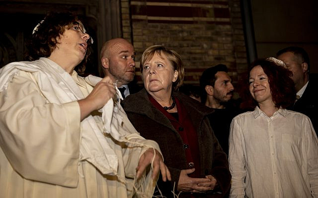German Chancellor Angela Merkel, Center, attends a solidarity event at the 'Neue Synagoge' (new synagogue) in Berlin. (Christoph Soeder/dpa via AP)