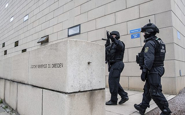 Police officers secure a synagogue in Dresden, Germany, Wednesday, Oct. 9, 2019.  (Robert Michael/dpa via AP)