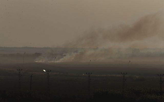 In this photo taken from the Turkish side of the border between Turkey and Syria, in Akcakale, Sanliurfa province, southeastern Turkey, smoke billows from target in Tel Abyad, Syria, during bombardment by Turkish forces, Saturday, Oct. 12, 2019. (AP Photo/Lefteris Pitarakis)