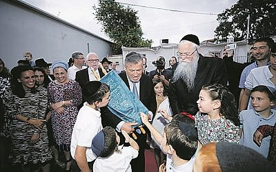 Leo with the Sefer Torah marking the opening of the new centre