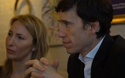 Rory Stewart listens intently during a trip to north London's Jewish community. He toured Golders Green and visited JW3.
