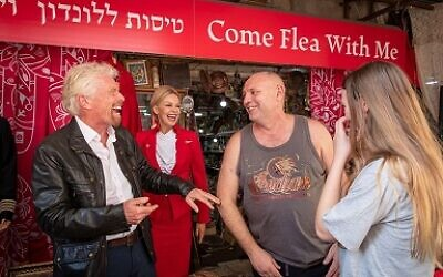 Sir Richard Branson haggling with a market-goer in Jaffa, where he gave away discounted flights!