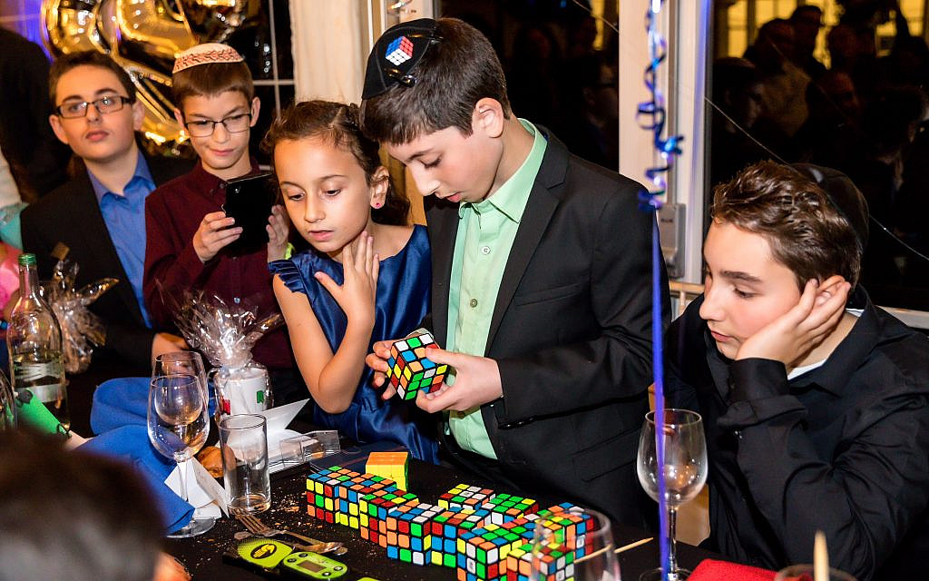 Barmitzvah boy solves 13 Rubik's cubes in under 4 minutes for charity