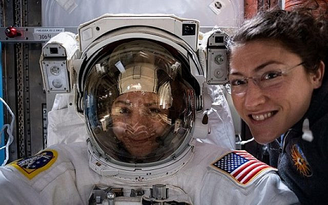 NASA astronaut Christina Koch (right) poses for a portrait with fellow Expedition 61 Flight Engineer Jessica Meir of NASA who is inside a U.S. spacesuit for a fit check.  This is ahead of their all-woman spacewalk on Friday 18 October.    (Credit NASA/ Link: https://images.nasa.gov/details-iss061e006798)