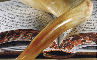 Shofar on top of a prayer book