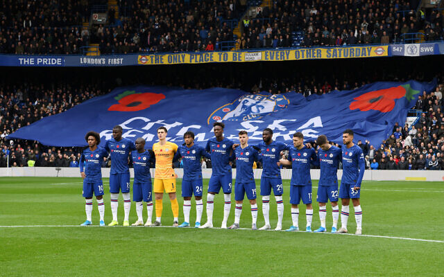 Players and fans of Chelsea observe a minute of silence in honour of Remembrance Day prior to the Premier League match between Chelsea FC and Crystal Palace at Stamford Bridge. (Photo by Chris Lee - Chelsea FC/Chelsea FC via Getty Images)
