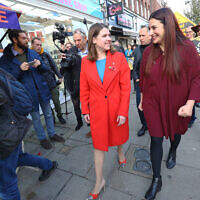 Liberal Democrat leader Jo Swinson (left) is greeted by the party's candidate for Finchley and Golders Green Luciana Berger (Credit: Aaron Chown/PA Wire)