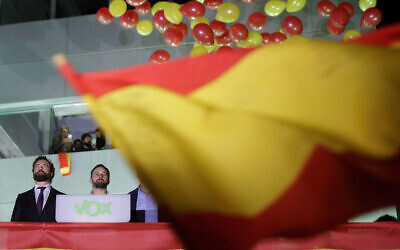 Santiago Abascal, leader of far-right Vox Party, 2nd left, looks at supporters outside the party headquarters after the announcement of the general election first results, in Madrid, Spain, Sunday, Nov. 10, 2019.   (AP Photo/Andrea Comas)
