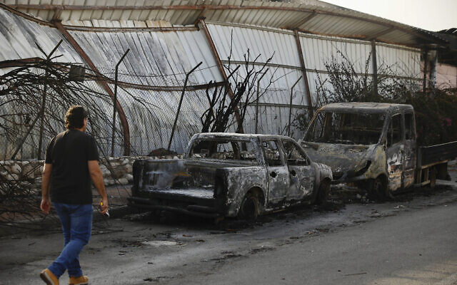 Burnt cars sit after a Tuesday's rocket firing from Gaza, in Sderot, southern Israel, Wednesday, Nov. 13, 2019. Gaza officials say new Israel airstrikes have killed a few militants. (AP Photo/Ariel Schalit)