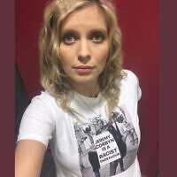 "Rachel Riley wearing a T-shirt of Labour leader Jeremy Corbyn holding a placard, reading: ""Jeremy Corbyn is a racist endeavour"". (Photo credit should read: Rachel Riley/PA Wire)"