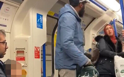 Screengrab taken with permission from the Twitter feed of Chris Atkins of a woman defending a family being harassed and targeted with antisemitic abuse by a man on a Northern Line train on Friday afternoon. (Photo credit: Chris Atkins/PA Wire)