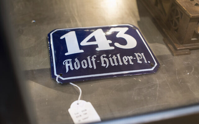 A street sign for '143 Adolf Hitler Place' is displayed for an auction at the 'Hermann Historica' auction house in Grasbrunn near Munich, Germany. A Geneva businessman says he has purchased Adolf Hitler's top hat and other Nazi memorabilia to keep them out of the hands of neo-Nazis and will donate them to a Jewish group. (Matthias Balk/dpa via AP)