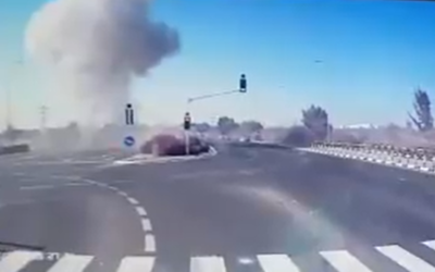 Screenshot from Twitter shows the moment a rocket hit a busy Israeli road