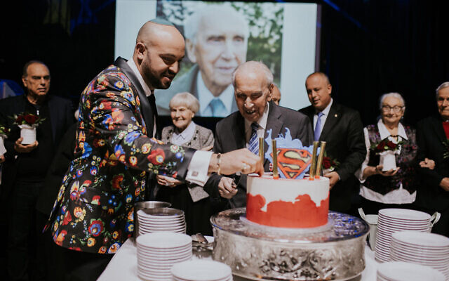 Jozef Walaszczyk cutting his 100th birthday as Righteous Among the Nations were honoured in Warsaw