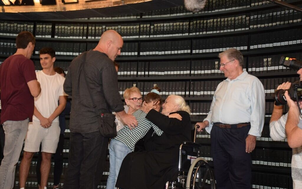 Holocaust survivors and their family meet Righteous Among the Nations Melpomeni Dina at Yad Vashem's Hall of Names  (Credit: Yad Vashem)
