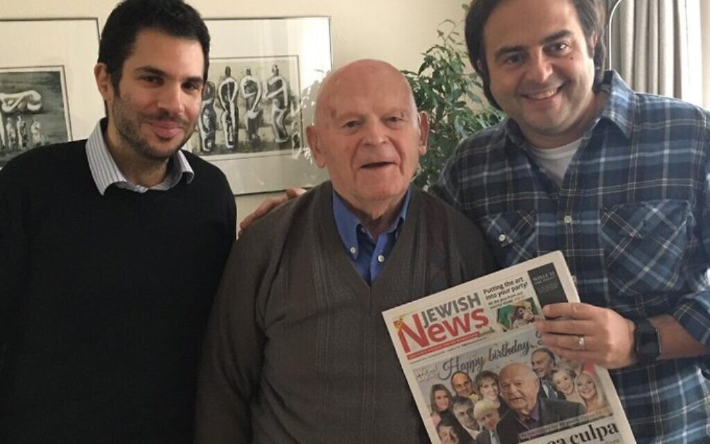 L-R: News Editor Justin Cohen, Sir Ben Helfgott and Editor Richard Ferrer, as the Holocaust survivor is presented with a copy of this week's Jewish News, which wishes him many happy returns from across the community and the country.