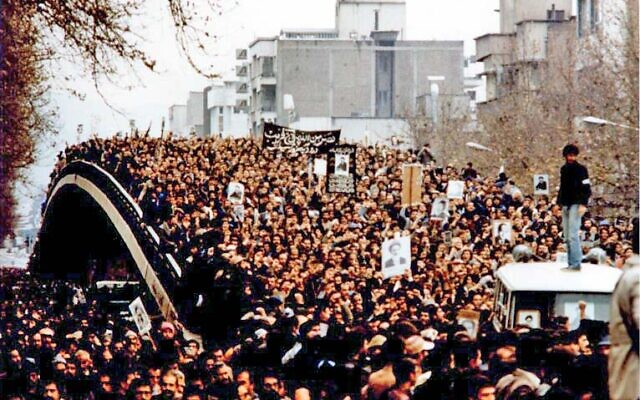 Demonstration in Iran during the revolution, with protesters holding up placards featuring the Ayatollah  (Wikipedia/  GNU Free Documentation License/Author: Unknown via Jewish News)