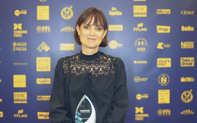 Amelia Gentleman with her award at the No2H8 Awards