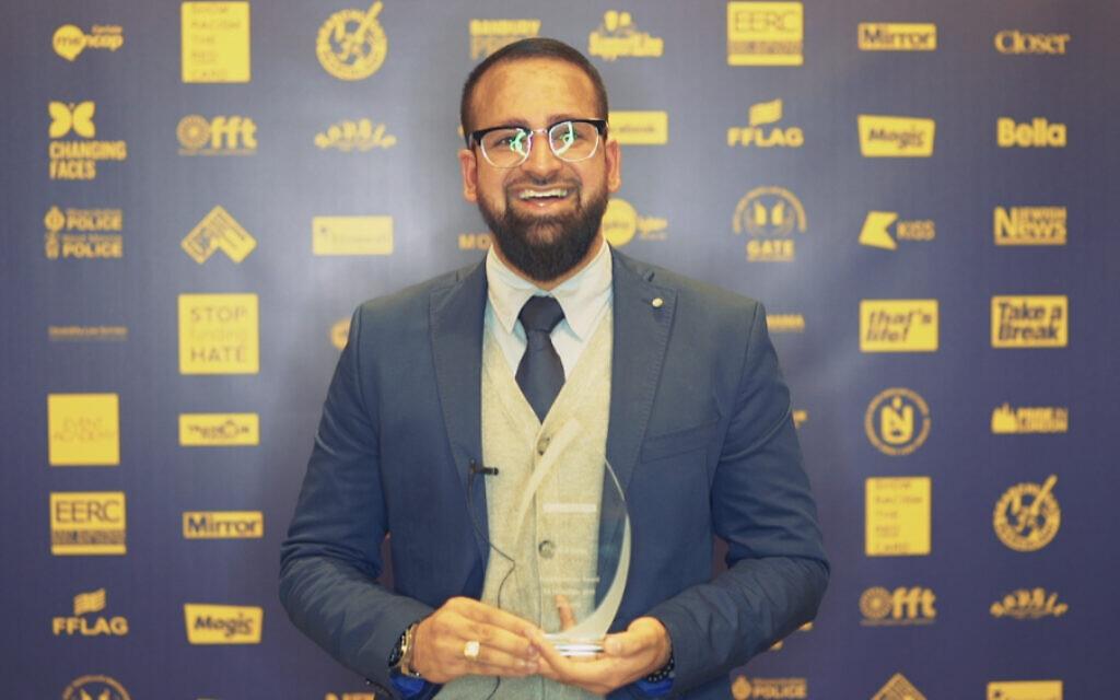 Yusuf Patel with his award at the No2H8 Awards