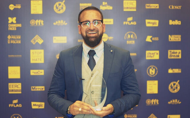 Yusuf Patel with his award at the No2H8 Awards