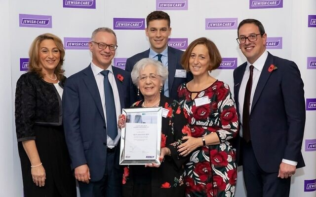 Helen Aronson (centre), winner of Jewish Care's Topland Business Luncheon Award with daughter Annie Fox, Steven Lewis, chair of trustees, grandson Daniel Fox, daughter Monica Huddie and Daniel Carmel-Brown, chief executive of Jewish Care