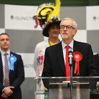 Labour leader Jeremy Corbyn speaks after the results was given at Sobell Leisure Centre for the Islington North constituency for the 2019 General Election. On the right is Jewish Brexit Party candidate, Yosef David. (Photo credit: Joe Giddens/PA Wire)