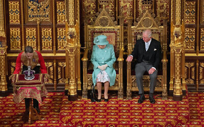 Queen Elizabeth II and the Prince of Wales sit in the chamber, alongside them is The Imperial State Crown, ahead of the State Opening of Parliament by the Queen, in the House of Lords at the Palace of Westminster in London. PA Photo. Picture date: Thursday December 19, 2019. See PA story POLITICS Speech. Photo credit should read: Leon Neal/PA Wire