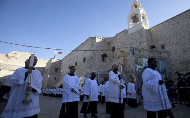 Clergymen participate in Christmas celebrations outside the Church of the Nativity, built atop the site where Christians believe Jesus Christ was born, on Christmas Eve, in the West Bank City of Bethlehem, Tuesday, Dec. 24, 2019. (AP Photo/Majdi Mohammed)